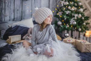 Baby Girl Next To The Christmace Tree - Atelier Kids Childcare Centre Blog - 5 Success Tips for Managing the Holidays